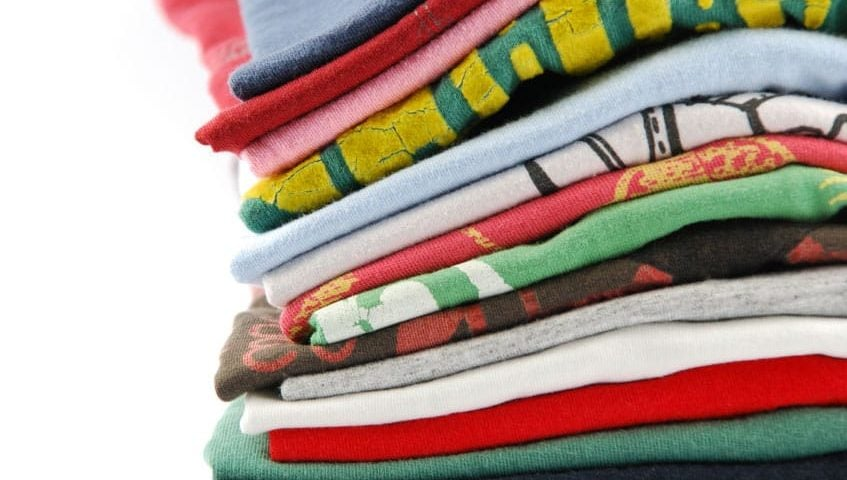 pile of folded colourful t-shirts
